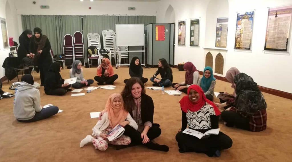 EPIC employee Mika sits with the Girls form the project in the Edinburgh Central Mosque