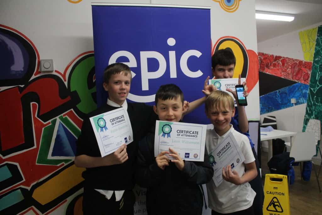 Four boys holding their certificates for the Scottish Youth Project