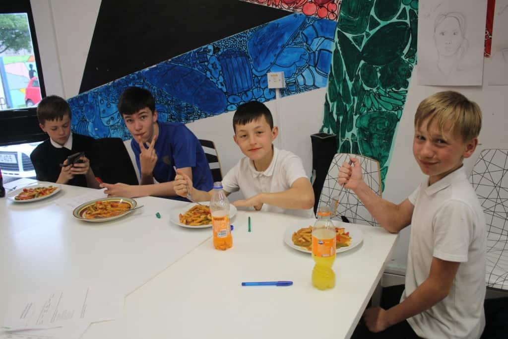 Scottish Boys Projects participants eating chicken fajita pasta